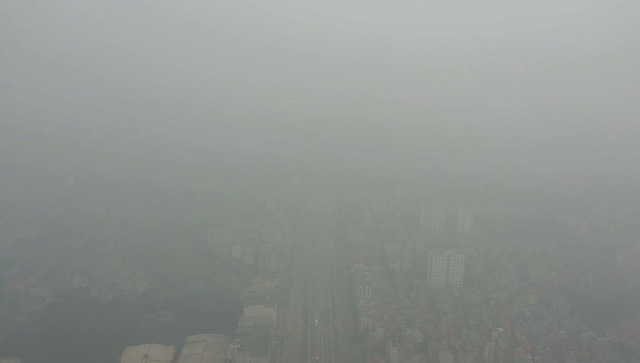 Nhiều tòa nhà mờ ảo nhìn từ flycam, chất lượng không khí ở Hà Nội suy giảm - Ảnh 6.