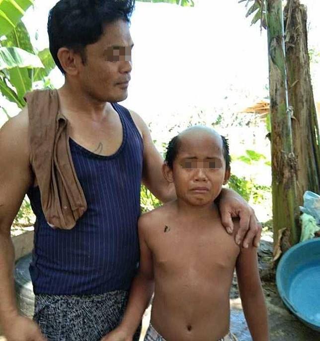 Ông bố quyết tâm cạo đầu cho con để cậu bé cảm thấy xấu hổ mà không trốn ra ngoài đi chơi trong mùa dịch - Ảnh 2.