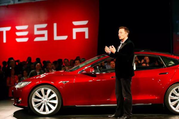 Cổ phiếu Tesla đột phá 2.000 USD, Phố Wall gây áp lực buộc GM phải chia tách kinh doanh - Ảnh 1.