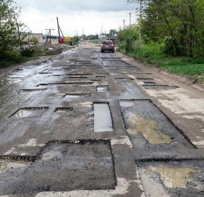 Những con đường xấu xí nhất quả đất - nhìn là chỉ muốn vác xe lên vai chạy bộ còn hơn! - Ảnh 20.