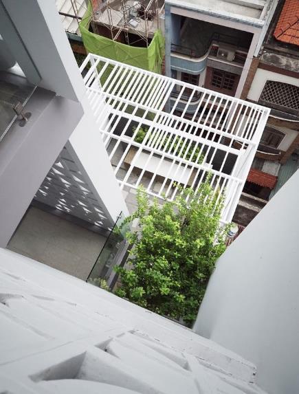 Ngôi nhà ống 7 tầng sâu hun hút ở TP. HCM đẹp ấn tượng trên tạp chí kiến trúc của Mỹ - Ảnh 12.