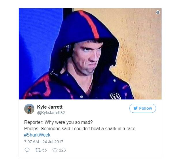 Phóng viên: Sao trông anh giận dữ vậy?  Phelps: Có người nói tôi không thể bơi thắng cá mập