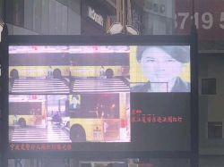 Hệ thống theo dõi người dân của Trung Quốc nhận diện nhầm khuôn mặt quảng cáo in trên xe buýt là người vi phạm giao thông - Ảnh 2.