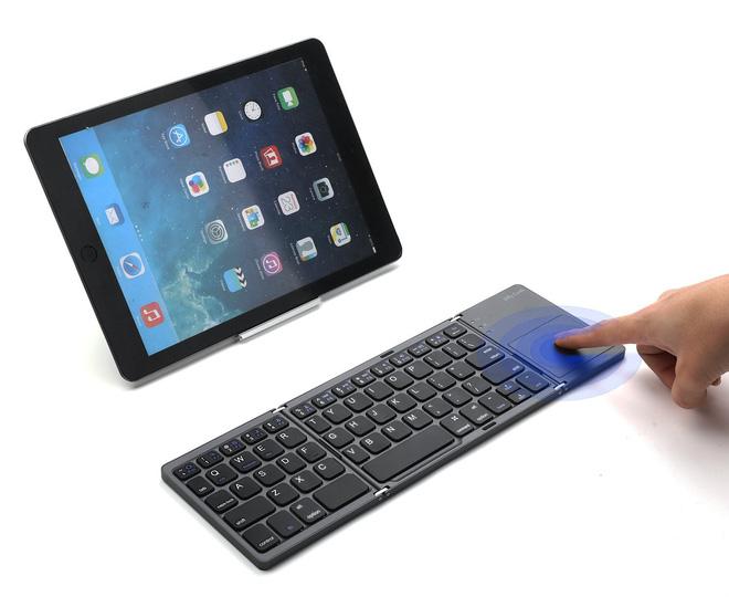 Đây là chiếc bàn phím có thể gập lại, thu gọn chiều dài chỉ còn 15 cm và có thể đem đi bất cứ nơi đâu - Ảnh 2.