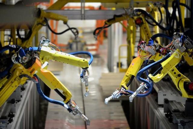 Đây mới là cách mạng 4.0: Tại nhà máy 30.000 robot cùng hoạt động, cứ 50 giây lắp xong 1 xe ô tô - Ảnh 4.