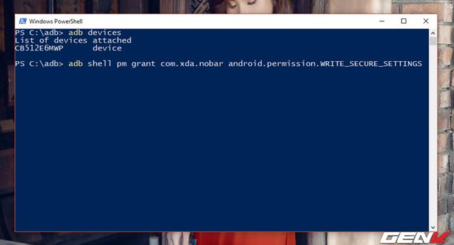 """Bước 7: Khi đã xác nhận xong, bạn hãy tiếp tục nhập lệnh """"adb shell pm grant com.xda.nobar android.permission.WRITE_SECURE_SETTINGS"""" vào cửa sổ dòng lệnh và nhấn phím ENTER để thực thi."""