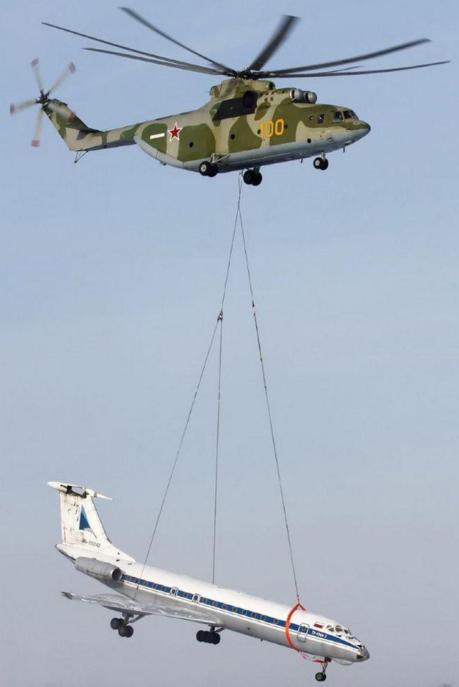 Khám phá trực thăng khổng lồ Mi-26 của Nga: Đã từng chở hóa thạch voi ma mút và máy bay chở khách cỡ nhỏ - Ảnh 13.