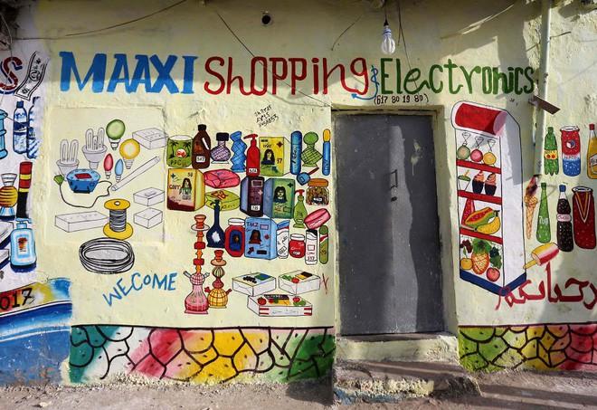 Tỷ lệ mù chữ quá cao, biển quảng cáo ở Somali chủ yếu là hình vẽ không cần đọc nhìn là hiểu - Ảnh 12.