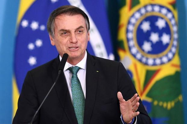 Thợ mỏ trái phép, nông dân và các nhóm khai thác tài nguyên của Brazil: Những thế lực đang âm thầm phá hủy lá phổi xanh Amazon - Ảnh 1.