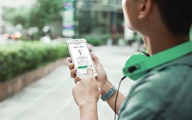 Cuộc chơi đốt tiền của Grab đang thay đổi thói quen thanh toán của người dùng Việt - Ảnh 1.