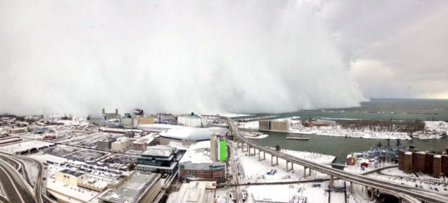 Holy mother of God, check out the giant snow wall swallowing Buffalo