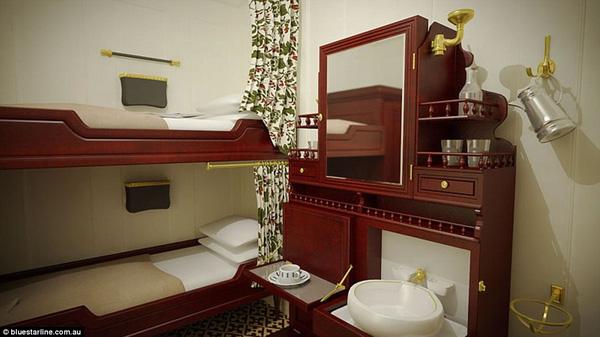 Buồng ngủ của vé hạng hai với giường tầng gỗ, tủ để đồ cùng bồn rửa mặt, có sức chứa tới 4 người.