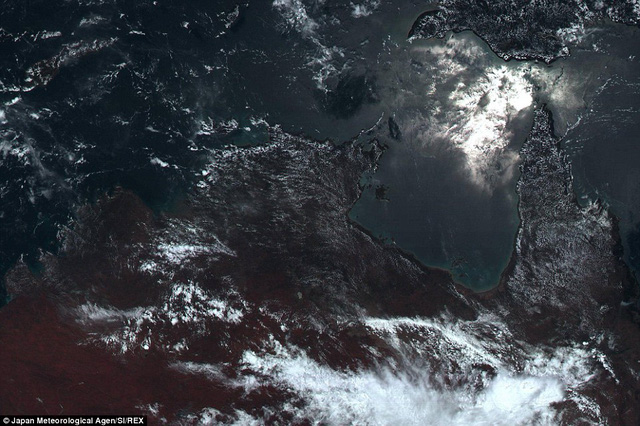 The stunning 11,000 x 11,000 pixel shot reveals a huge amount of detail. Here can be seen the north coast of Australia, with the suns light glinting in the Arafura Sea, while wisps of clouds can also be seen at the bottom of the image