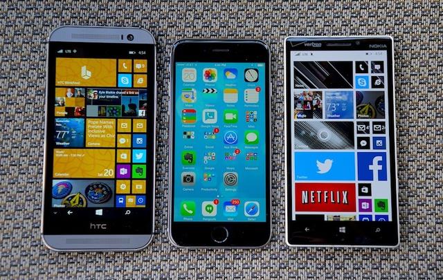 OS-X YOSEMITE:private:var:folders:rt:1py6_06d1bj6w_1tcqhc0hn00000gn:T:TemporaryItems:iphone-6-vs-windows-phone.jpg