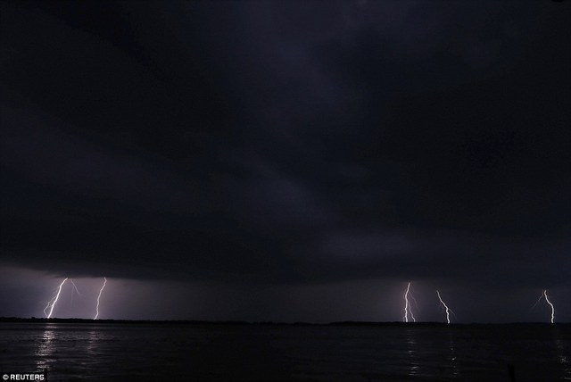 Lightning strikes can be seen on the horizon over Lake Maracaibo in the village of Ologa, where the Catatumbo River feeds into the lake