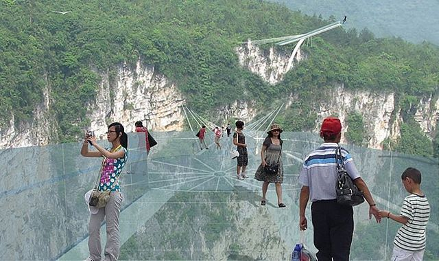 Dizzyingly high at about 400 m (1,312 ft) above the canyon floor, the glass bridge will carry up to 800 people at a time
