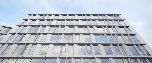 Văn phòng được tạo ra từ hai tòa nhà hình lập phương ghép vào với nhau xung quanh đại sảnh hình chữ V.