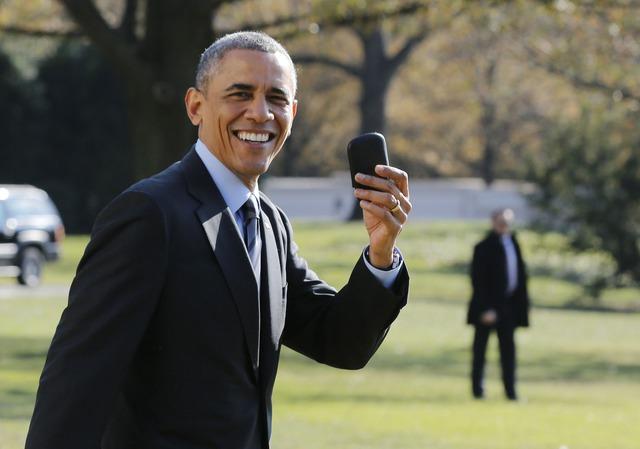 Obama và chiếc BlackBerry quen thuộc trước đây của mình