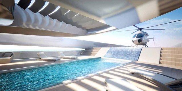 Bên trên có đến hai bể bơi, một bể có thác nước mini. Và có cả bệ đáp máy bay trực thăng.