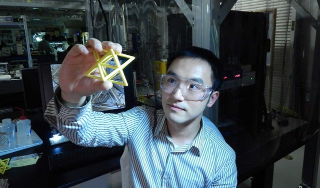 Lawrence Livermore Engineer Xiaoyu Rayne Zheng studies a macroscale version of the unit ...