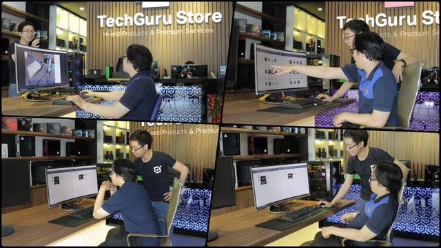 Nhân viên của TechGuru Store đang tư vấn sản phẩm màn hình máy tính mới nhất cho khách hàng