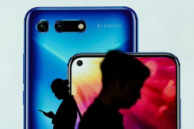 Reuters: Huawei đang đàm phán bán bộ phận Honor - Ảnh 1.