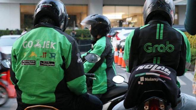 Grab và Gojek sắp hoàn tất các điều khoản sáp nhập - Ảnh 1.