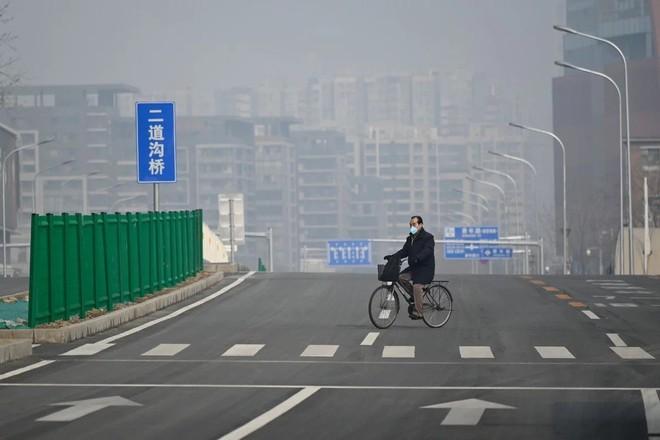 Giữa cơn bão dịch Covid-19, Trung Quốc nâng cấp công nghệ để nhận diện gương mặt của cả những người đang đeo khẩu trang - Ảnh 4.