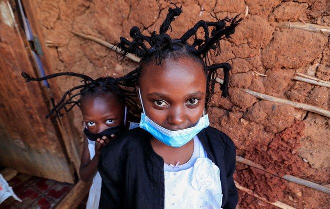 Kiểu tóc phổ biến nhất ở khu ổ chuột tại Kenya được lấy cảm hứng từ virus corona - Ảnh 2.