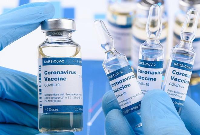 Một thử nghiệm vắc-xin Covid-19 tiềm năng vừa thông báo xuất hiện tác dụng phụ - Ảnh 1.