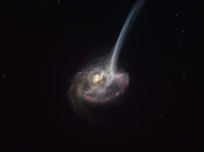 Thiên hà có đuôi này đang chết, mỗi ngày rò rỉ ra không gian lượng vật chất tương đương 10.000 ngôi sao - Ảnh 1.