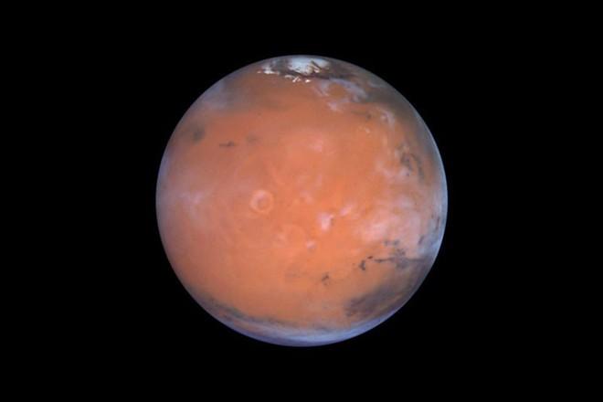 Elon Musk hứa sẽ đưa người lên định cư Sao Hỏa vào năm 2026, đây là 3 trở ngại lớn khiến kế hoạch này vẫn phi thực tế - Ảnh 1.