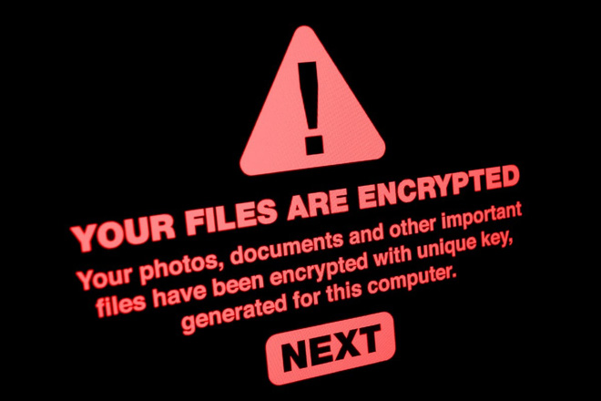 Đòi tiền chuộc đến 70 triệu USD, cuộc tấn công Ransomware lớn nhất thế giới được nhóm hacker REvil thực hiện như thế nào? - Ảnh 2.
