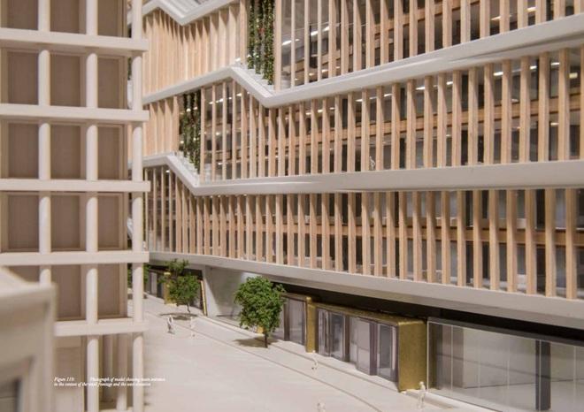 Tòa nhà có rất nhiều tầng với cửa sổ bao quanh từ sàn đến trần nhà.