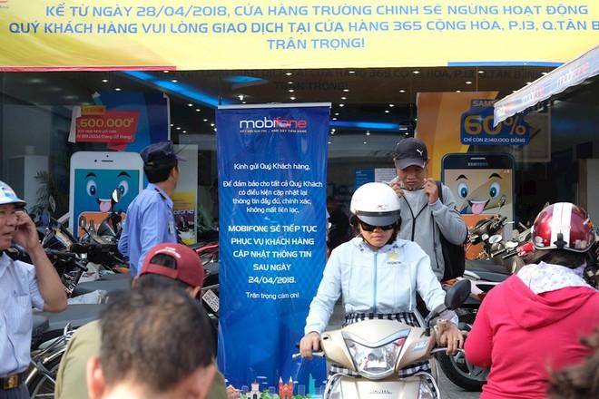Hình ảnh người dân TP HCM chen lấn đi đăng ký thông tin trước giờ G - Ảnh 4.