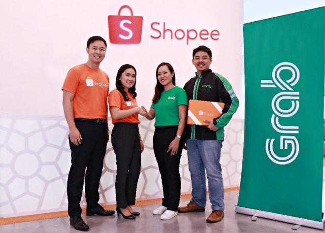 Shopee hợp tác với Grab cung cấp dịch vụ giao hàng trong ngày cho khách - Ảnh 1.