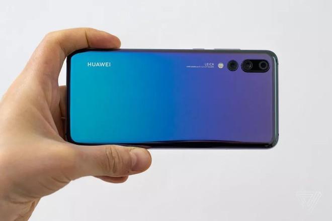 Vượt mặt Apple, Huawei trở thành nhà sản xuất smartphone lớn thứ 2 trên thế giới - Ảnh 1.