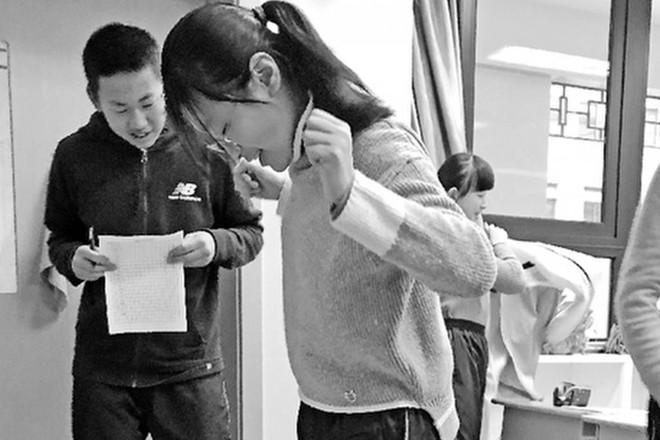 Trung Quốc: Học sinh nào tăng quá 2kg sau khi ăn Tết sẽ bị phạt chạy bộ mỗi ngày - Ảnh 1.