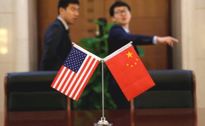 Tại sao chiến tranh thương mại Mỹ-Trung lại khiến các công ty công nghệ Trung Quốc như ngồi trên đống lửa? - Ảnh 1.