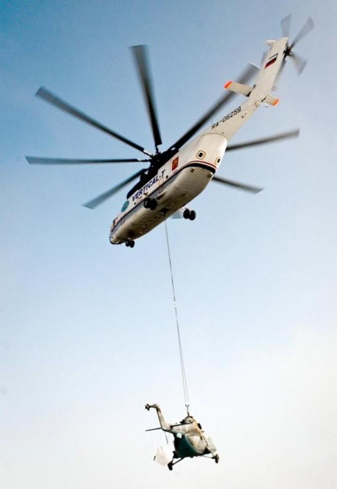 Khám phá trực thăng khổng lồ Mi-26 của Nga: Đã từng chở hóa thạch voi ma mút và máy bay chở khách cỡ nhỏ - Ảnh 3.