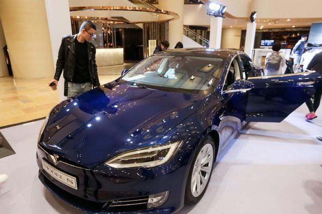 Nhóm nghiên cứu vừa hack thành công hệ thống tự lái Autopilot của Tesla từng hack Safari trên Mac OS chỉ trong 20 giây - Ảnh 1.
