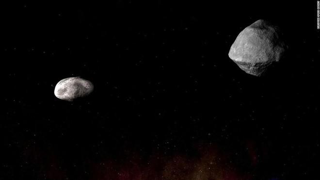 Sáng ngày mai, một cặp thiên thạch có thể gây nguy hại sẽ bay lướt qua Trái Đất ở khoảng cách gần chưa từng có - Ảnh 1.