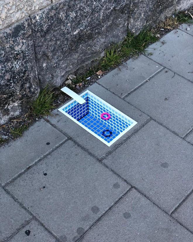 Nghệ sĩ Thụy Điển được tôn vinh vì phá hoại đường phố bằng pixel-art - Ảnh 2.