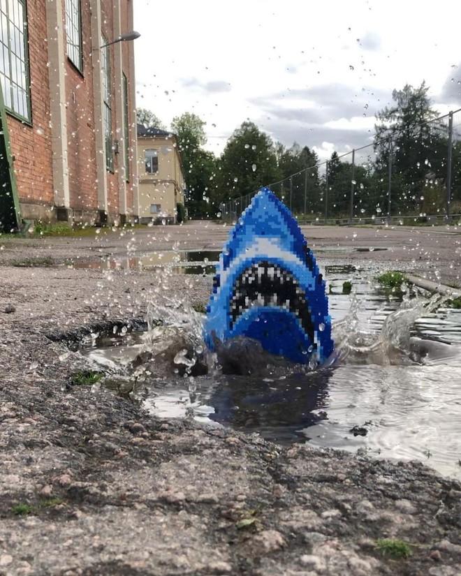 Nghệ sĩ Thụy Điển được tôn vinh vì phá hoại đường phố bằng pixel-art - Ảnh 14.