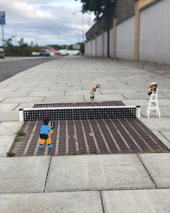 Nghệ sĩ Thụy Điển được tôn vinh vì phá hoại đường phố bằng pixel-art - Ảnh 19.