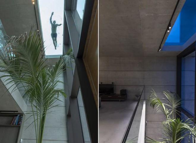 Ngắm kiến trúc nhà phố độc đáo với không gian hiện đại, có phòng tập thể dục, chiếu phim và hồ bơi trong suốt trên nóc nhà - Ảnh 4.