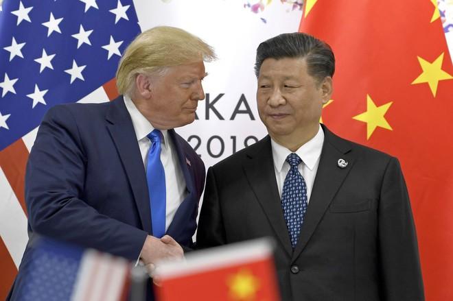 Ông Trump nói sẽ cho phép các công ty Mỹ tiếp tục bán hàng cho Huawei - Ảnh 1.