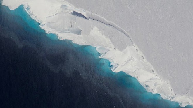 Mực nước biển sẽ tăng thêm 0,9m trong vòng 80 năm tới, hàng triệu người sẽ phải di tản - Ảnh 1.