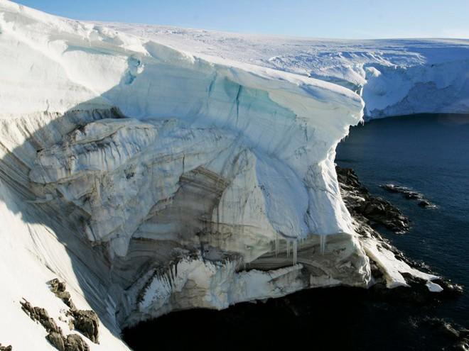 Mực nước biển sẽ tăng thêm 0,9m trong vòng 80 năm tới, hàng triệu người sẽ phải di tản - Ảnh 3.