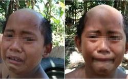 Ông bố quyết tâm cạo đầu cho con để cậu bé cảm thấy xấu hổ mà không trốn ra ngoài đi chơi trong mùa dịch